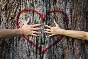 Couple touching heart