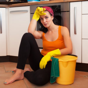 Overworked woman in the kitchen