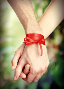 Hands tied with ribbon