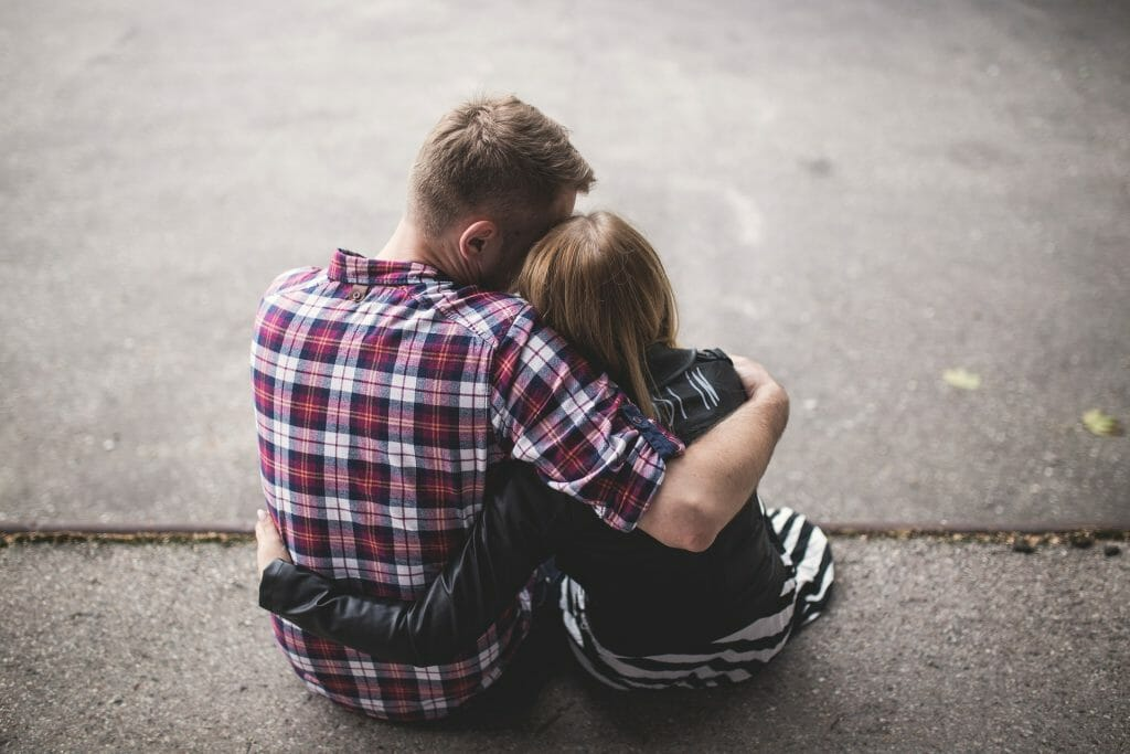 Couple comforting each other