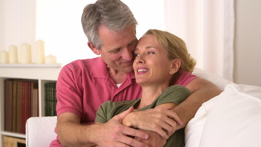 Man comforting woman