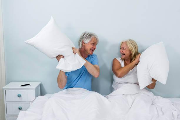 Happy senior couple playing