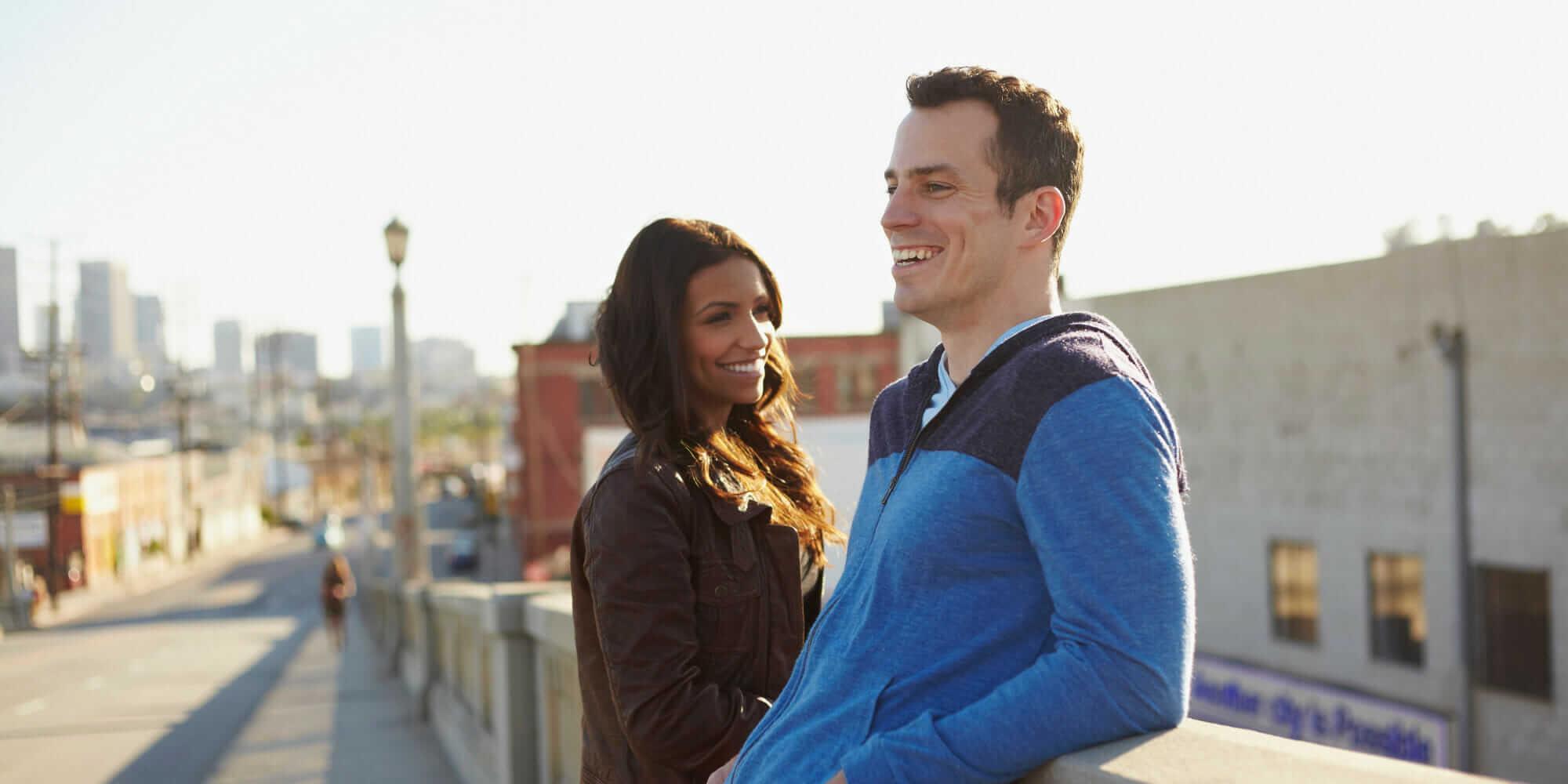 Couple chatting on bridge
